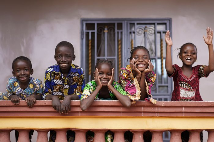 African children waving